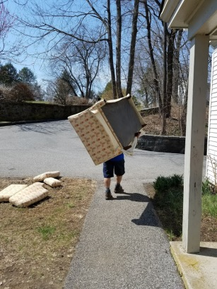 Moving company dude carrying my sofa by himself!